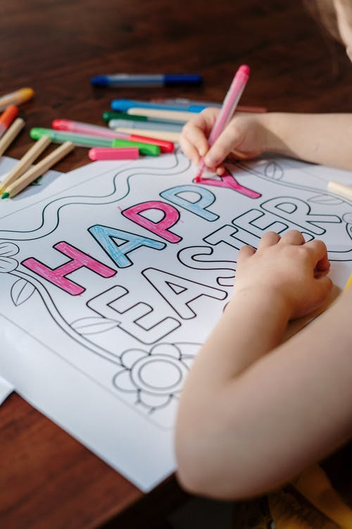 Person Coloring Happy Easter Print on White Paper