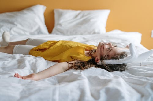 Girl in Yellow Dress Lying on Bed