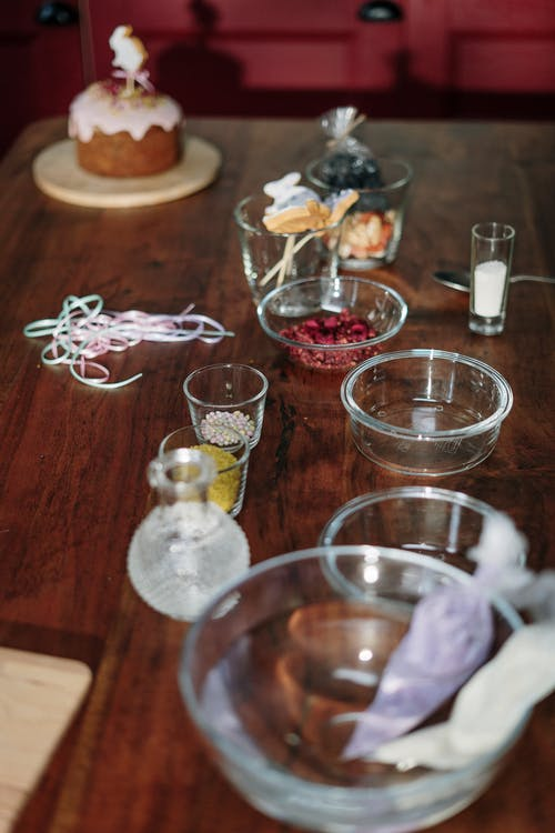 Clear Drinking Glasses on Brown Wooden Table