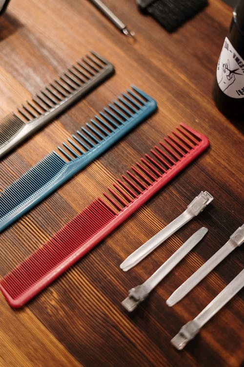 Red Hair Comb on Brown Wooden Table