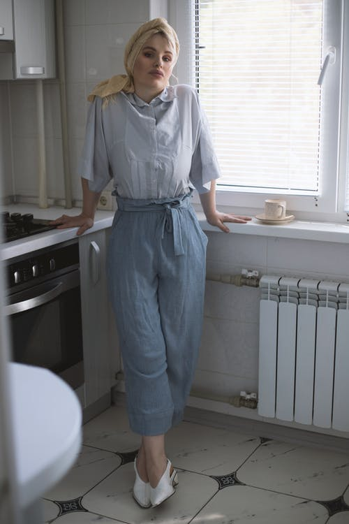 Woman in Blue Denim Dungaree Standing in the Kitchen