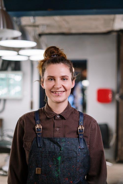 Smiling Woman in Brown Jacket