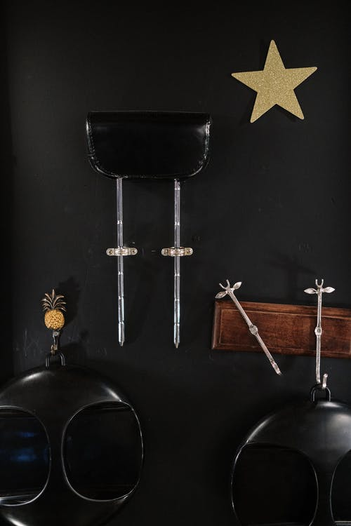Silver Cross and Two Black Bar Stools