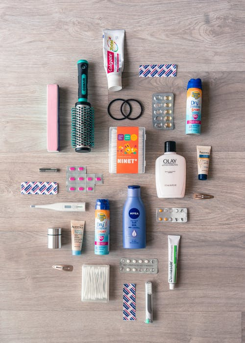 Flat Lay Photo of Essential Toiletries