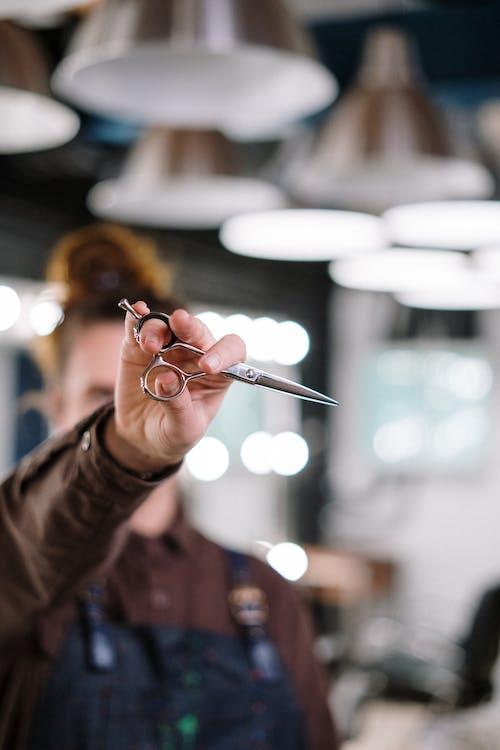 Person Holding Silver Scissors