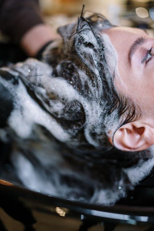 Woman Getting Her Hair Shampoo