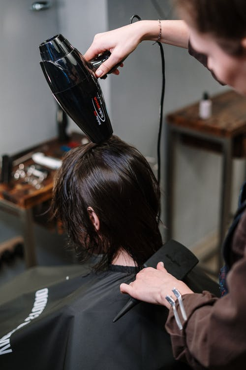 Woman Getting Her Hair Dry