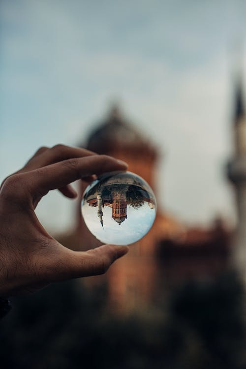 Person Holding Clear Lens Ball