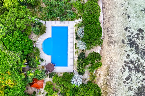 Aerial Shot Of Swimming Pool By The Sea