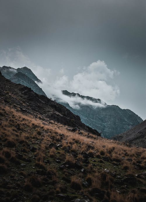 Landscape of Mountains Under  Gray Sky