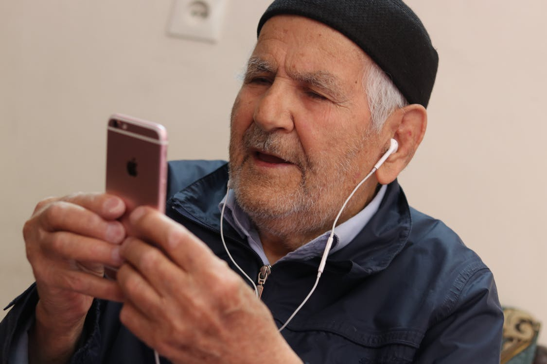 Man in Black Knit Cap Holding Iphone 6