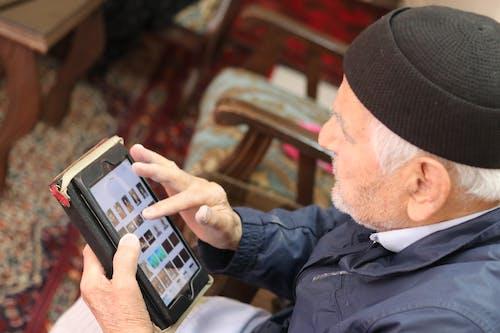 Free stock photo of apple, grandfather, ipad, old man