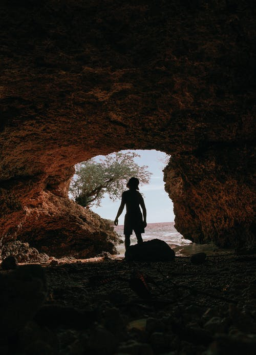 Person Inside A Cave