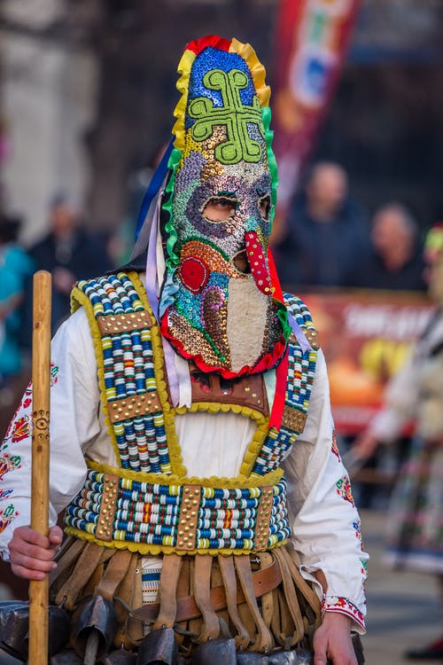 Person Wearing Yellow Blue and Red Mask