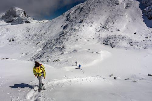 People Climbing Up Mountain