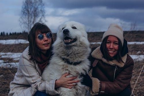 Women Beside A Dog