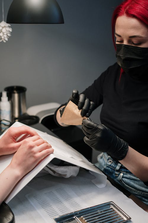 Woman in Black Long Sleeve Shirt Dong Manicure