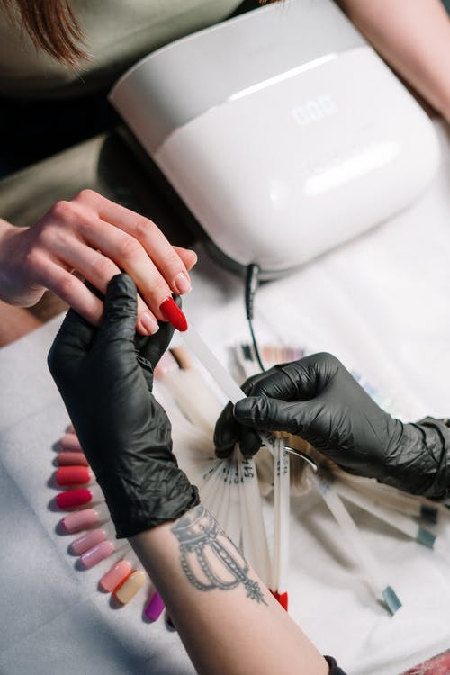Person Wearing Black Gloves Making Nails