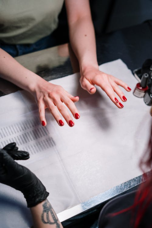 Person with Red Manicure