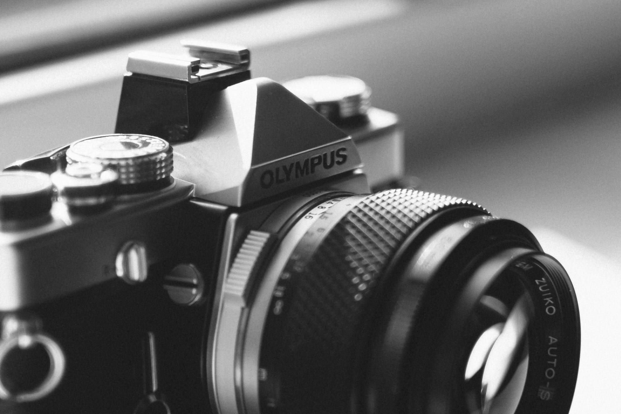 Gray Scale Photo of Olympus Dslr Camera
