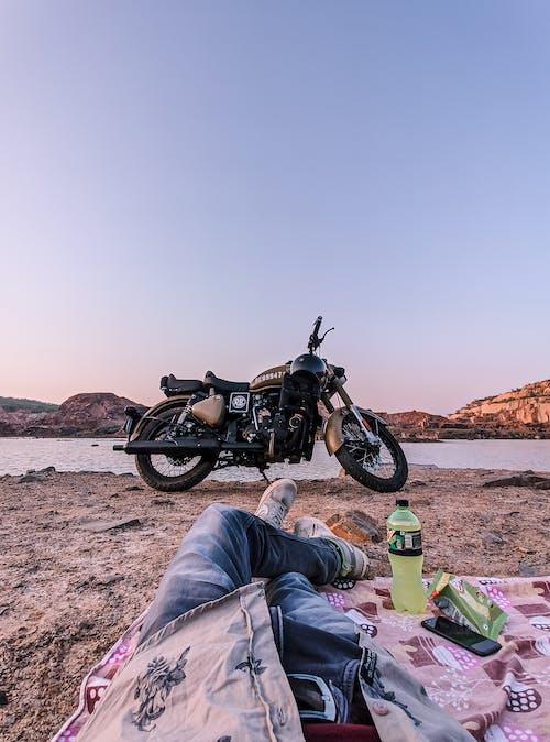 Parked Motorcycle Near Lake