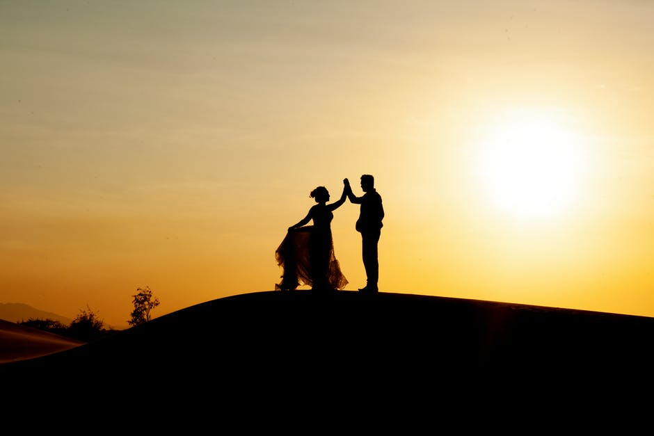 Silhouette of newly wedded couple
