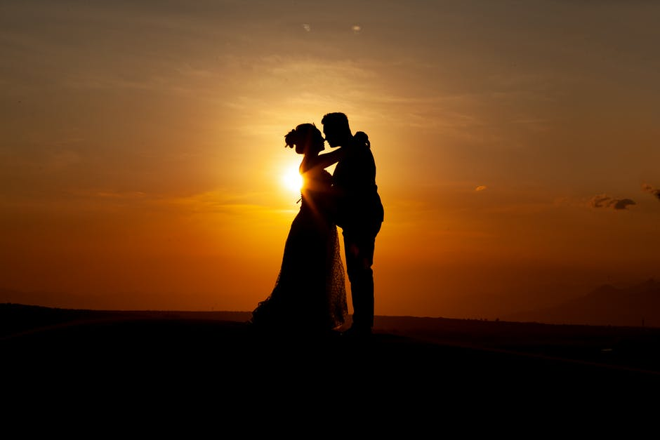 Silhouette of couple kissing during sunset