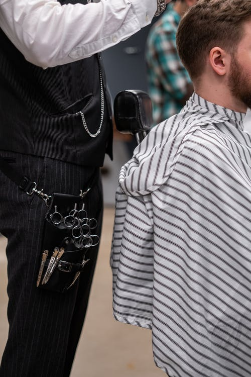 Photo of a Barber Giving a Haircut