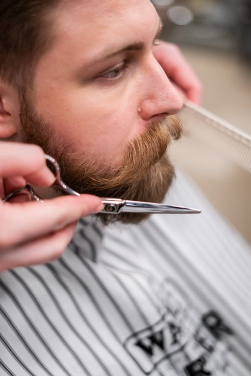 Man Getting a Beard Cut