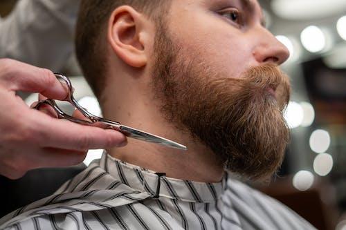 Man Getting a Beard Cut