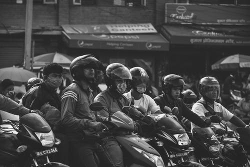 Grayscale Photo Of Men Riding Motorcycles
