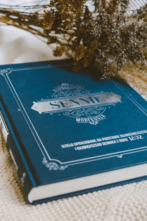 Blue and White Book on White Textile