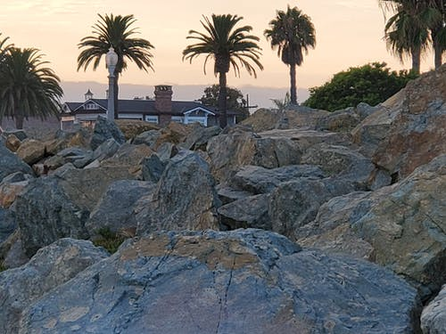 Základová fotografie zdarma na téma honí západy slunce, oceány, pěší turistika, pobřeží