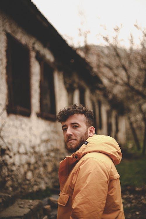 Man In Orange Hoodie