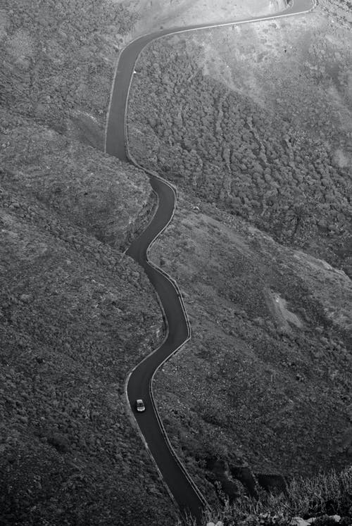 Grayscale Photo Of Road On The Mountain