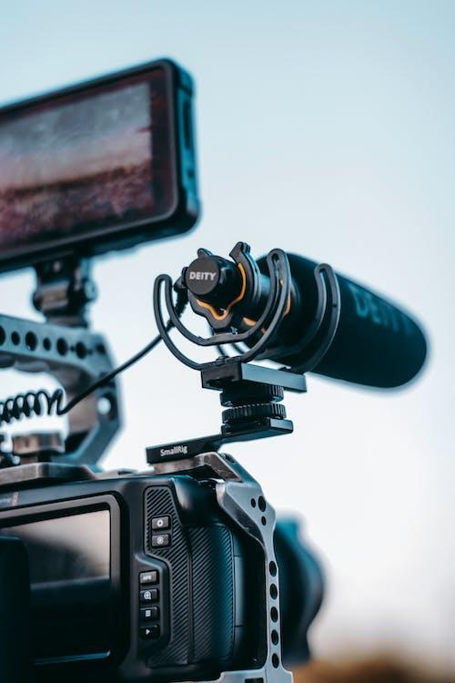 Black Dslr Camera And Mic
