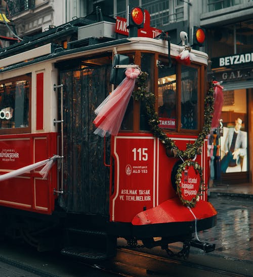 Red And White Tram On The Street