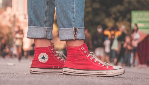 Person In Red Converse All Star High Top Sneakers