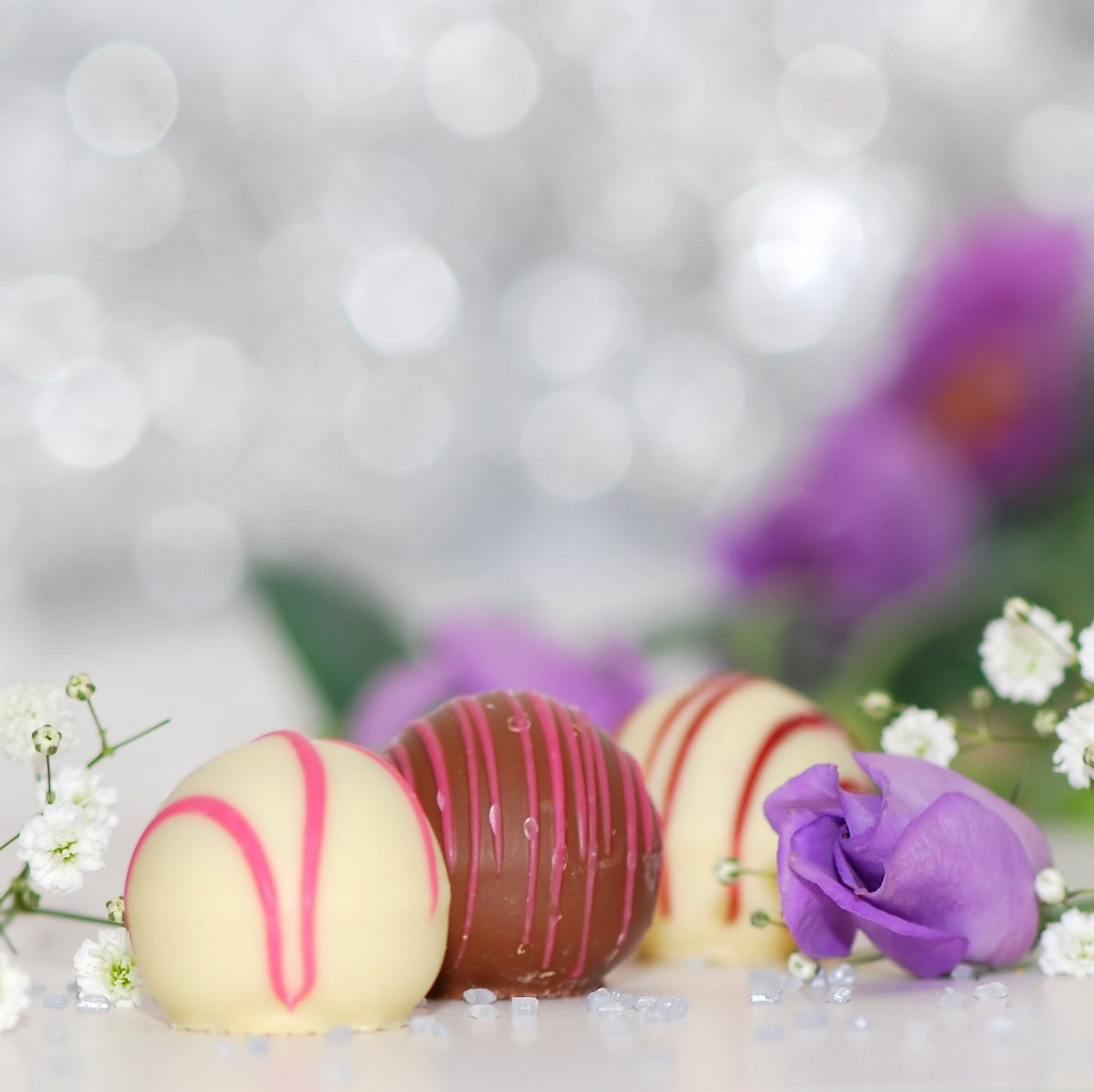 White and Chocolate Sweets With Purple Petal Flower Photo