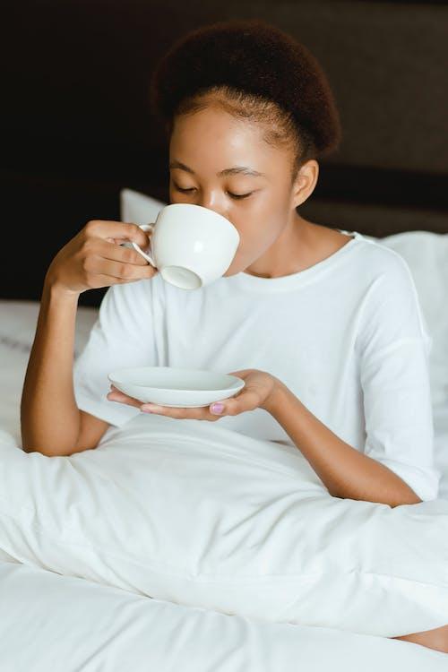 Woman In White Crew Neck T-shirt Holding White Ceramic Mug