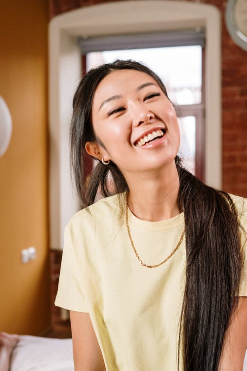 Woman in White Crew Neck Shirt Smiling