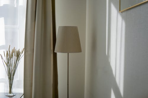 White Floor Lamp Beside A Curtain