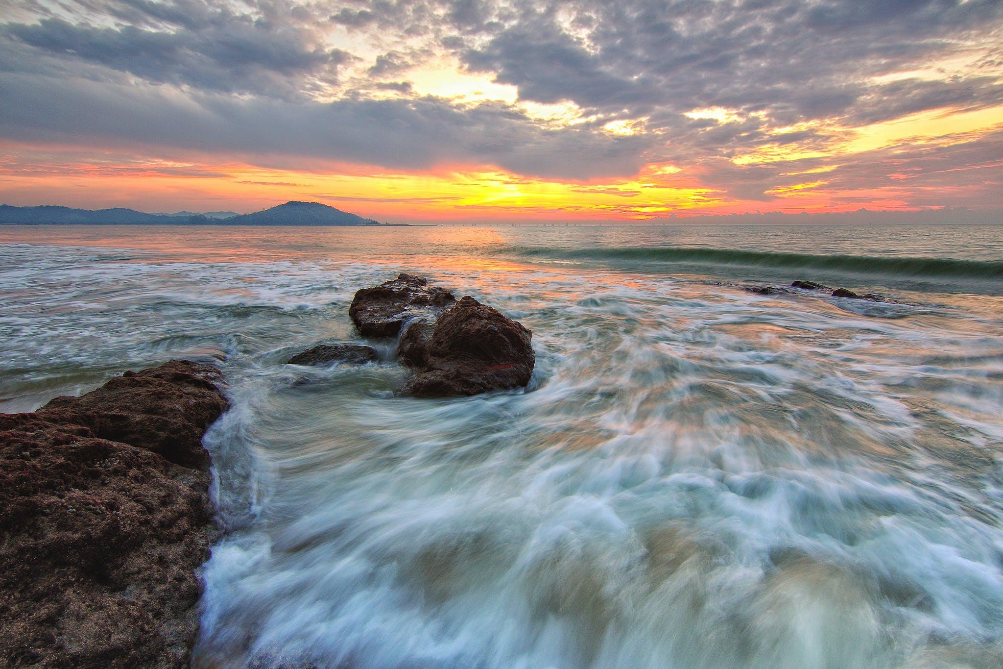 Ocean Under White Clouds during Orange Sunset