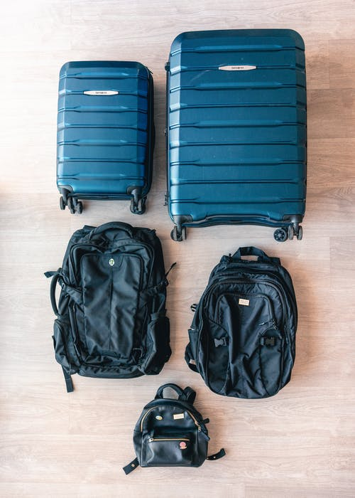 Flat Lay Of Luggage And Bags