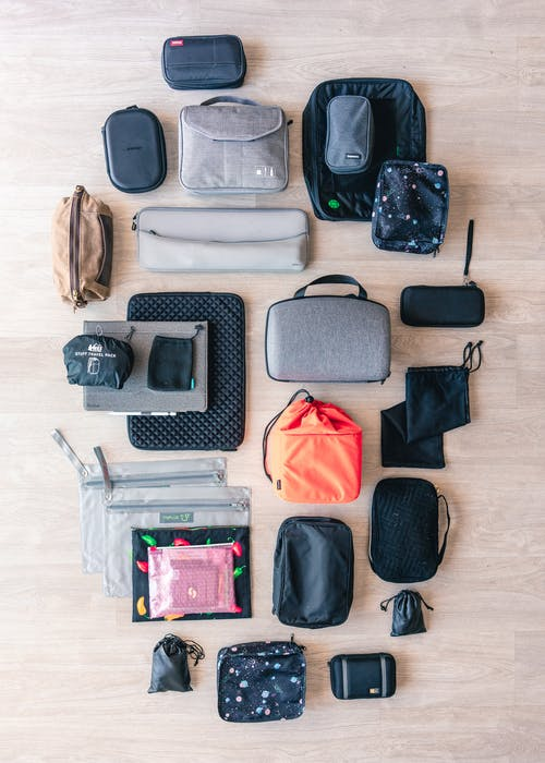 Flat Lay Of Pouches And Bags