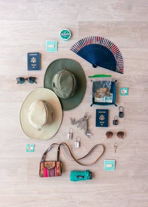 Flat Lay Of Hats And Accessories