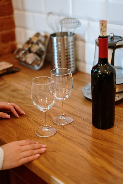 Wine Bottle and Wine Glass on Table