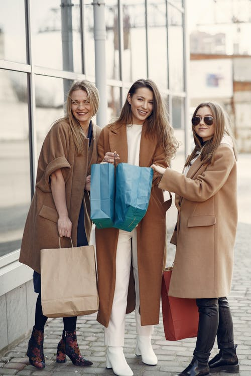 Happy women enjoying purchases after shopping