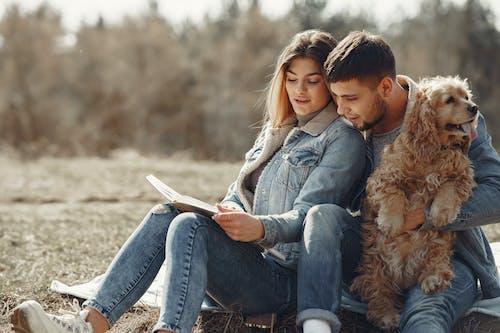 Boy in Blue Denim Jacket Sitting Beside Girl in Brown Fur Coat