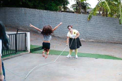 Kostnadsfri bild av flicka, fritid, hopprep, kvinna
